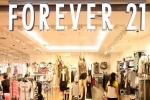 forever 21 filing for bankruptcy, forever 21, forever 21 burdened by debt considers filing for bankruptcy, Clothing
