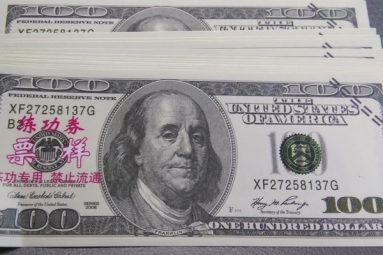 Counterfeit money featuring Chinese letters found in Kingman