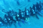 NRI and team break Guinness world record for the longest human chain underwater, Nri Along With a Team Creates Guinness World Record, nri and team creates guinness world record, Human chain