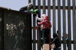 punjabi women, punjabis Crossing Border Fence, video clip shows punjabi women children crossing border fence into u s, North america
